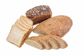 picture of whole-grain  - Bread with bran partly sliced sliced bread for toasting and brown bread with whole grain cereals on a light background - JPG