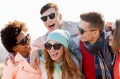people, friendship and teenage concept - group of happy friends in sunglasses having fun and laughin poster