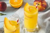 Refreshing Peach And Orange Fuzzy Navel Cocktail poster