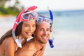 Snorkel beach summer happy couple holiday portrait. Travel vacation snorkelers smiling asian woman,  poster