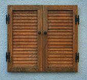shutters on a wall of a stucco house