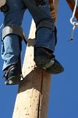 an electrical lineman student working on a pole at a lineman college