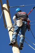 image of lineman  - an electrical lineman student working on a pole at a lineman college - JPG