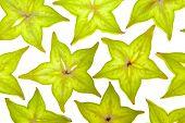 Starfruit (carambola) slices on white background