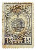 RUSSIA - CIRCA 1946: stamp printed in USSR, shows partisans awards with portraits her leaders - Jose