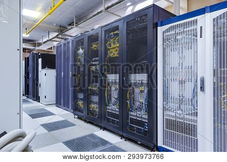 poster of Control Modules With Modern Communication Equipment, Switches And Cables In Server Room. Data Center