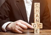Businessman Points To Wooden Blocks With The Word Change To Chance. Personal Development. Career Gro poster