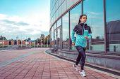 Woman Girl In Summer Jogging In City, Sportswear Windbreaker Leggings. Free Space For Text. In The M poster