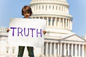 Protester Boy Child Holding Sign Demanding Truth poster