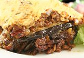 picture of greek food  - Lamb moussaka with egg plant cheese and salad - JPG