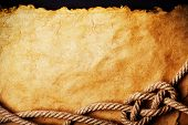 stock photo of treasure map  - aged Rope on the old paper background - JPG