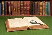 Antique Books, Candlestick And Magnifier