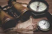 Travel Or Adventure Background. Adventurer Table. Binoculars, Envelope With Letter, Compass And Pock poster