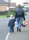 image of school lunch  - Mother and kid walking to school - JPG