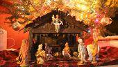 image of manger  - manger scene displayed under a christmas tree - JPG