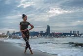 A Young Girl Enjoys A Walk On The Ocean. Evening Walk On A Deserted City Beach. Evening Pattaya, Tha poster