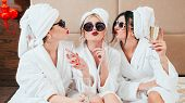 Celebration Party At Spa. Friends Congratulation. Young Women With Champagne. Sunglasses, Bathrobes  poster