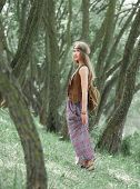 Attractive Hippie Girl Standing Among The Trees In The Forest poster