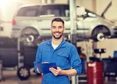 car service, repair, maintenance and people concept - happy smiling auto mechanic man or smith with  poster