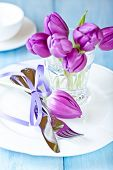 Easter place setting with purple tulips