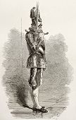 Swiss guard in Vatican city holding two-handed sword. Created by Neuville, published on Le Tour du M
