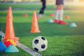 Football And Soccer Training Equipment On Green Artificial Turf poster