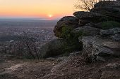 Sunset Over Small Town Landscape. Beautiful Landscape Of Small Town With Rocks In Foreground. Stunni poster