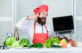 Hipster In Hat And Apron Buy Products Online. Shopping Online. Man Chef Searching Online Ingredients poster