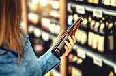 Customer Buying Beer In Liquor Store. Lager, Craft Or Wheat Beer. Ipa Or Pale Ale. Woman At Alcohol  poster