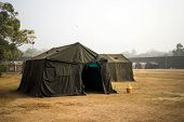 Military Tent In The Field. Big Tent City. Field Camp In Nature. Military Base With Temporary Barrac poster