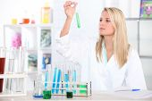 Female chemistry student with a test tube