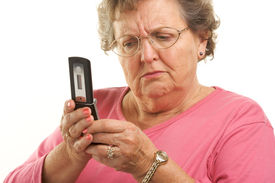 picture of beautiful senior woman  - Frustrated Senior Woman Using Her Cell Phone - JPG