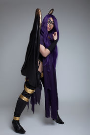 picture of banshee  - girl stand in purple witch cosplay costume anime character - JPG