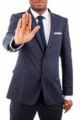 Afroamerican businessman in suit showing STOP, isolated on white poster