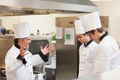 picture of outrageous  - Head chef scolding employees in the kitchen - JPG