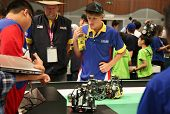 SUBANG JAYA - NOV 10: Unidentified students watch their robots with built in programmed response com
