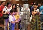 SUBANG JAYA - NOVEMBER 10: Unidentified visitors interact with a robot at the World Robot Olympaid o