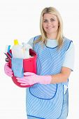 Cleaner woman holding a bucket in the white background