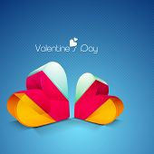 Colorful 3D heart shapes on blue background for Valentines Day.