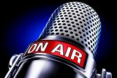 picture of interview  - high resolution rendering of a microphone with a on air icon - JPG