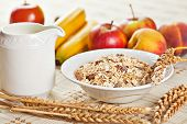 stock photo of dry fruit  - Healthy eating breakfast low calories bowl of swiss muesli with fruits and milk - JPG