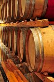 pic of wine cellar  - Stacked oak wine barrels in winery cellar - JPG