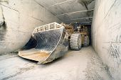 Big Bulldozer In Marble Tunnel, Carrara, Italy
