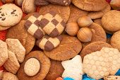 crackers/biscuits and hazelnuts as background