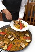 Paella/typical spanish dish with rice and vegetables