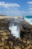 Waves Crashing Through Rocky Opening