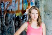 Teenage Girl with Graffiti Wall In Background