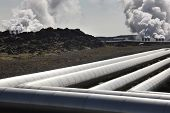picture of chimney rock  - Geothermal pipes and power station on volcanic rocks landscape in Iceland - JPG