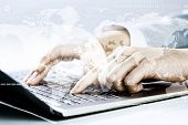 Close up image of businesswoman hands typing on keyboard