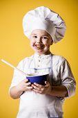 Little boy chef in uniform